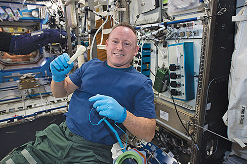 "International Space Station Expedition 42 commander Barry ""Butch"" Wilmore shows off a ratchet wrench made with a 3D printer on the station. It took about four hours for the printer to make the wrench, thereby allowing astronauts to reliably print what was required and not depend on carrying supplies from the Earth (Image courtesy: www.nasa.gov)"