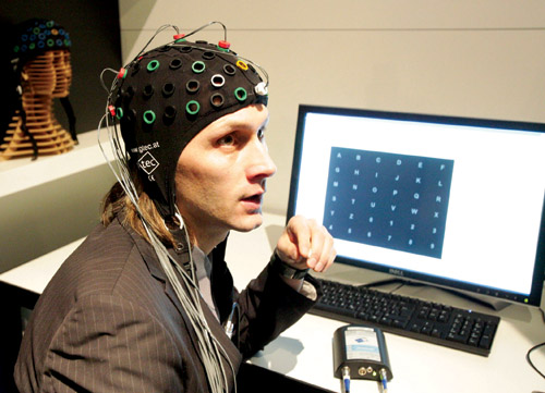 A researcher sporting brain-computer interface headgear (Courtesy: www.oxbridgebiotech.com)