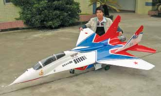 A programmable, radio-controlled model aircraft