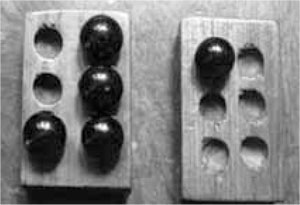 Conventional braille teaching relies on the use of a wooden plate that has six dips representing a Braille cell and a glass marble that has to be placed in the dips to form a Braille character