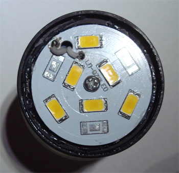 Figure3. Inside view of an 8 Watt LED bulb showing the placement of six power LEDs. The LEDs are mounted on an aluminium core printed circuit board for improved heat removal.