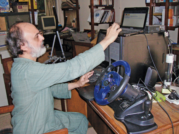 Mehta with 'Arpit's wheel' tool for the disabled
