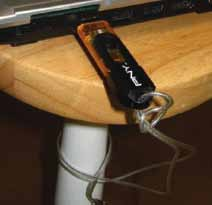 Fig. 5: Laptop locked to a table using USB flash drive