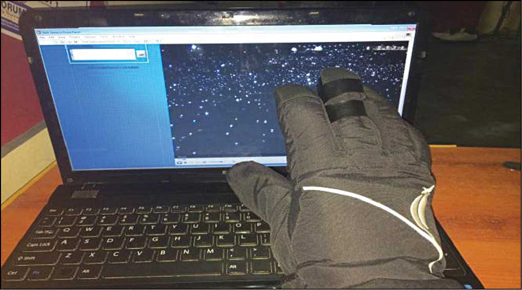 Fig. 1: Sixth-sense media player being operated using a hand glove