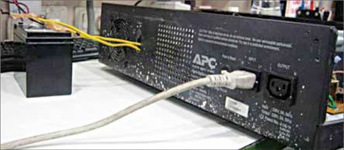 Fig. 3: Rear panel of APC 800VA inverter showing input cord and output socket