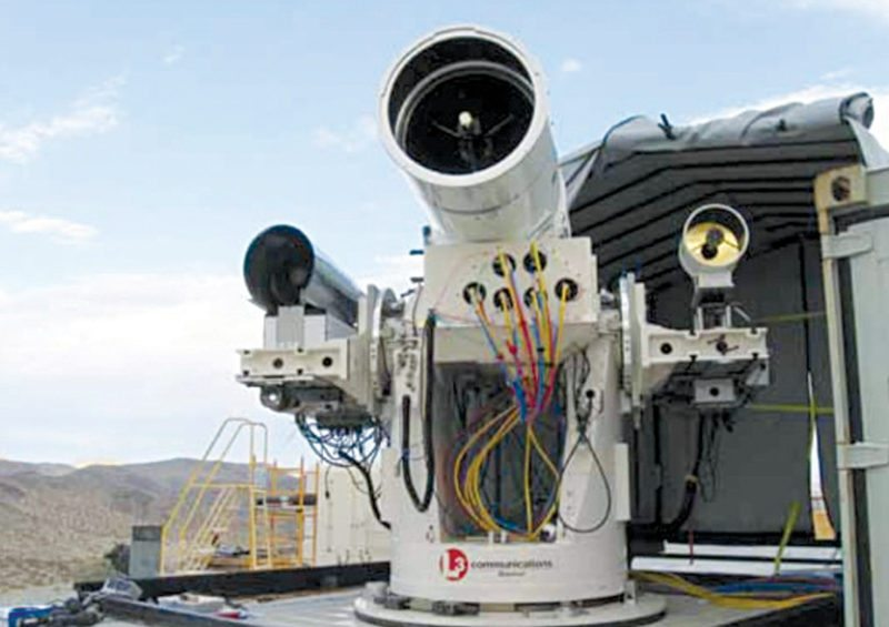A laser with US Naval Sea Systems Command (NSSC), which is an electromagnetic gun prototype (Image courtesy: www.occupycorporatism.com)