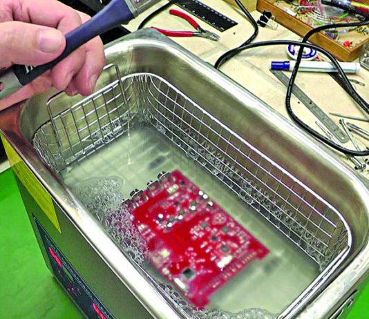 Removal of flux from printed circuit board using an ultrasonic cleaner
